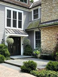 awnings over doors ways to add color to your exterior copper accents exterior colors and curb