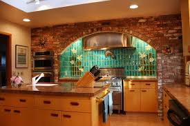 brick kitchen with ceramic tile backsplash