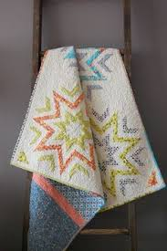 Blue Moon River: How to make a quilt sleeve | Quilt free patterns ... & The Brown Needle: finished starburst quilt Adamdwight.com