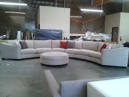 amusing fabric upholstery curved sectional sofa with round ottoman coffee table for best furniture
