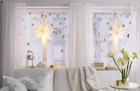 Astonishing Window Christmas Decorations Applying Large Bright Star Lights  Hung With Smaller Ornaments In Window