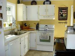 image of yellow and white kitchen cabinets