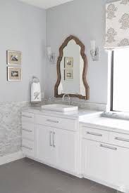 white transitional bathroom wood mirror white cabinets carrara marble 1