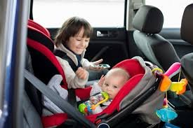 baby and toddler in car seat