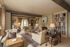 rustic the wooden beams dissecting this living room give the 4million new build build home cotswold