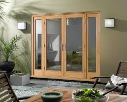 open french doors. oak wood french doors patio exterior open out with side windows, glass insert and metal handle plus wall mounted lamp white shades