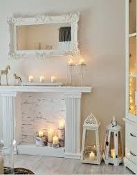 decorative fireplace white brick wall birch wood pillar candles