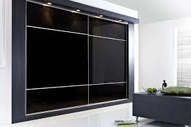 sliding wardrobe doors in black glass