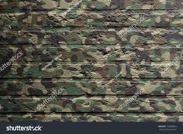 brick wall with a painting of a flag isolated camouflage