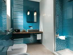 teal blue bathroom decor dark brown lacquered wooden counter top and drawers black wall tile mirror