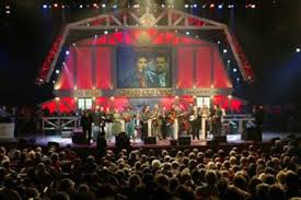 Image result for the Grand Ole Opry begins live radio broadcasting from Nashville, Tennessee.