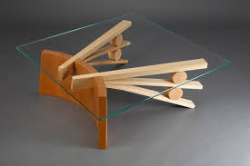 square glass top coffee table with curved wood base made from coopered cherry and bent ash
