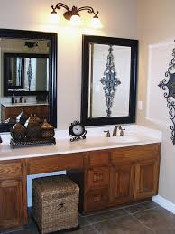 twin mirrors in black frame with overhead lighting
