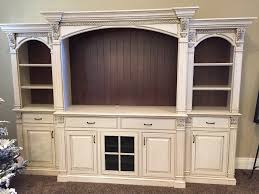 Antiqued white entertainment center with bead brown backs, fluted ...