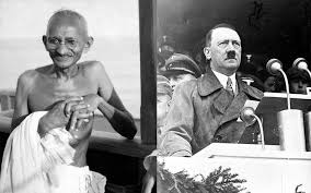 left mahatma gandhi aboard the s s rajna en route to the second round table conference on dominion status for india right german chancellor adolf