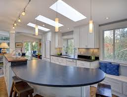 interesting track lighting kitchen net ideas. Wonderful Lighting Curved Kitchen Island With Wooden Barstools Idea Feat Modern Track Lighting  And Chic Painted Cabinet Design In Interesting Net Ideas