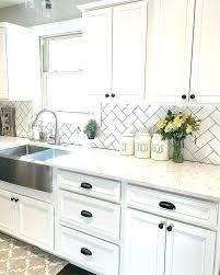 backsplash with black granite black and white street contemporary kitchen kitchen white cabinets black granite backsplash
