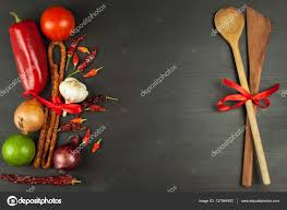 wooden spoons and vegetables on a black table food preparation decoration advertising the restaurant