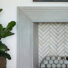 gray beveled fireplace mantel with concrete fire
