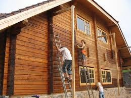 exterior paint application. log cabin exterior painting paint application