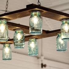 mason jar hanging lights the couple created their own impressive light fixture out of mason jars