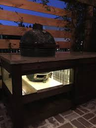 the perfect big green egg table with concrete top barn door and built in