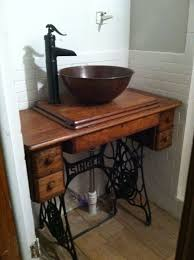this is a sewing machine table from we took out the machine added the pipes bowl and faucet and now i have a unique bathroom sink vanity combination
