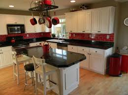 black and red kitchen design. white cabinets, black countertop and red backsplash? kitchen design