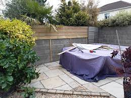 cladding a garden wall with timber