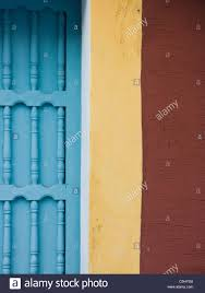 Colonial Spanish buildings facades painted with bright colors in the heart  of the historic city of Antigua, Guatemala