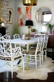 dining room with marble table and br base with faux bamboo chairs
