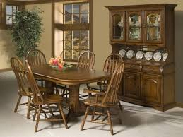 country style dining room with cappuccino finish china cabinet hutch amish american windsor dining chairsfloating wide laminate flooring and