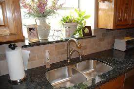 verde erfly granite kitchen traditional with granite countertop tile backsplash verde