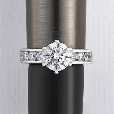 round diamond with channel set diamonds