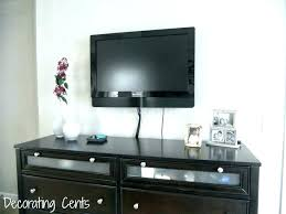 hide tv wires home depot in wall how to without cutting above fireplace behind