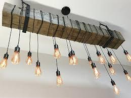 reclaimed barn beam light fixture with edison bulb wrapped lights bar restaurant home