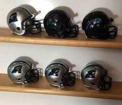 These helmets were the cherry on top of of the best jerseys in sports history. 6 Carolina Panthers Complete Nfl Helmet History Riddell Pocket Pro 2 Two Bar Riddell Carolinapanthers Helmet Nfl Football Helmets Carolina Panthers