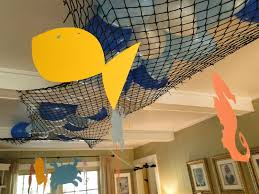 fishing nets balloons and paper fish is an inexpensive and easy and awesome decorating idea