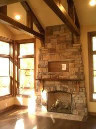 rustic stone fireplace rustic stone fireplace reclaimed wood beams vaulted ceiling great room meadow creek with rustic stone fireplace rustic stone