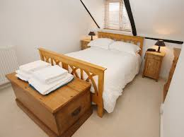 attic bedroom furniture. A White Bedroom With Beautiful Natural Wood Furniture Including The Dresser, Nightstands, Bed Frame Attic