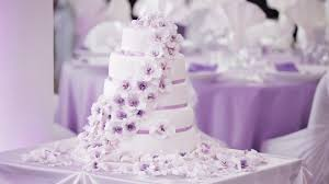 Beautiful Wedding Cake Decorated In White With Purple Flowers Stock