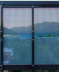 perforated metal screen. View Of Mountains Through Perforated Metal Screen. Screen