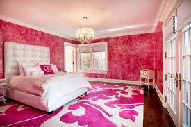 pink bedroom with shiny pink chandelier