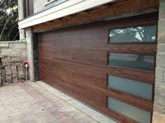 Modern Fiberglass Garage Doors with Door Lites installed by Modern