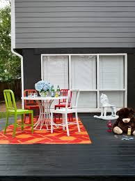 black deck with red and orange patterned rug