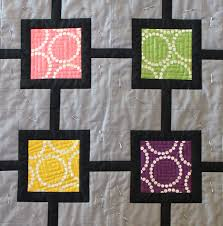 How to Free-Motion Quilt on a Regular Sewing Machine & String of Pearls Quilt Adamdwight.com