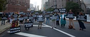 "families of muslim political prisoners in the united states ""war metropolitan correctional center protesters hold signs the s of political prisioners from the ""war on terror"" new york city c tom martinez"