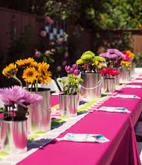 paint can centerpieces with pretty flowers birthday party painting