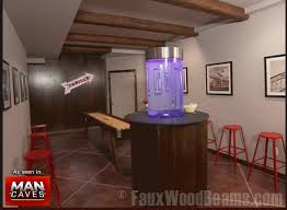 Using artificial wood ceiling beams helps to draw together the color scheme  of the room. Man Cave dcor featuring faux ...