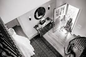 ballroom style wedding dress bride and mom checking out wedding dress